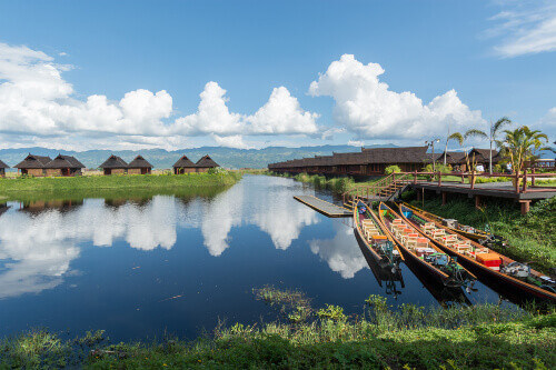 The beautiful Inle Lake with straw houses reflecting on the waters surface in Shan State Myanmar
