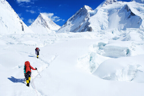 Climber reaching the summit of Everest in Nepal