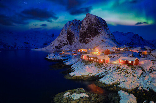 Famous tourist attraction Hamnoy fishing village with red rorbu houses on Lofoten Islands Norway