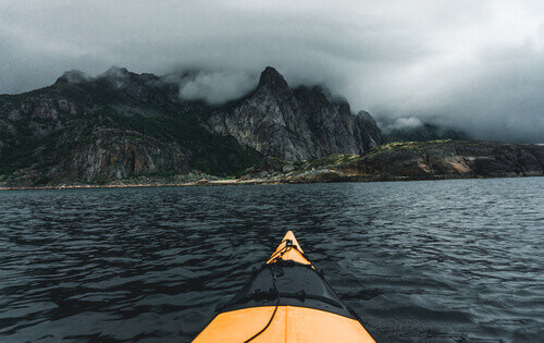 Small yellow kayak in bay on Lofoten islands Norway