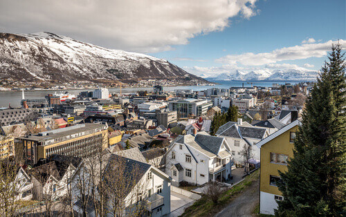 View of arctic town of Tromso with old wooden houses in Norway