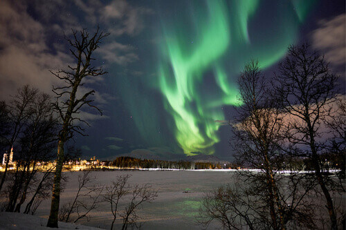 Northern lights display above Prestvannet in Tromso Norway