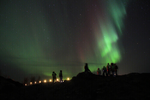 People braving the cold to watch the Northern lights in Tromso Norway