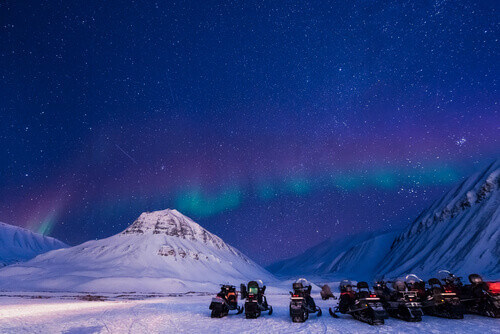 The polar arctic Northern lights aurora borealis sky in Svalbard Norway