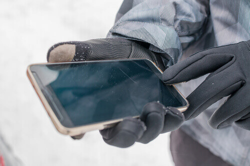 Using smartphone in winter Norway with gloves for touch screens