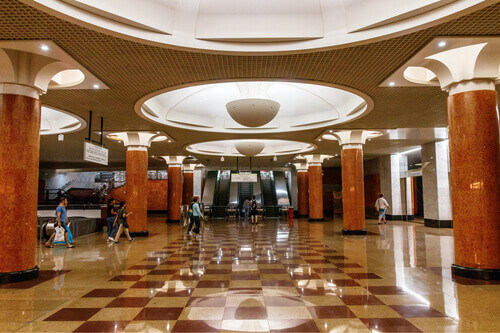Passengers in the entrance and exit hall of the Park Pobedy metro station in Moscow Russia