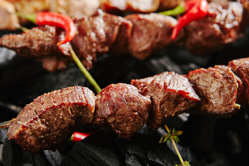 Hot Grilled Beef Kebab or Russian Barbecue Shashlik with Herbs and Spices