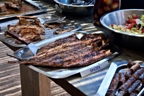 Freshly grilled snoek fish served at restaurant, traditional south african dish in South Africa