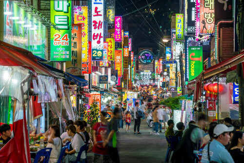 People on Pojangmacha eating and drinking at Nampo-dong street market in Busan South Korea