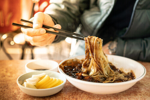 Jajangmyeon or Jjajangmyeon (Noodles in Black Bean Sauce) is a Korean noodle topped with a thick sauce made of chunjang or diced pork and vegetables. Popular in South Korea