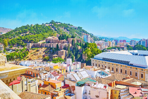 The rooftop of Malaga Cathedral with the medieval Alcazaba Fortress and the Gibralfaro Castle visible.