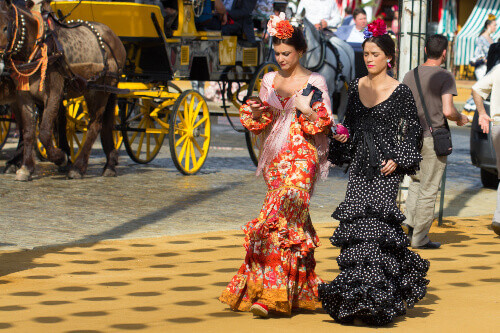 Women dressed in traditional costume at the Sevilles April Fair in Seville Spain