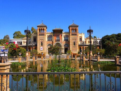 An ornamental lake in the gardens of the Alcazar Palace in Seville Spain