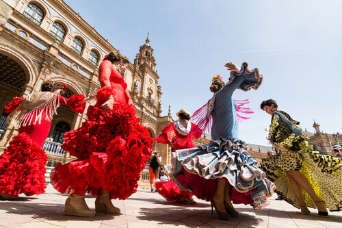 Young women dance flamenco on Plaza de Espana in Seville Spain