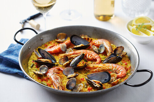 Typical spanish seafood paella in traditional pan in Valencia Spain