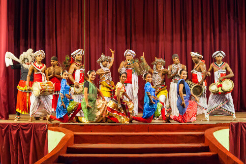 Group of artists posing at the Cultural Kandyan Dance Show in Kandy, Sri Lanka