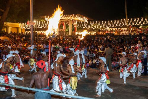 Pathuru Dancers perform in front of a huge crowd at the Esala Perahara in Kandy Sri Lanka