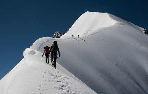 A group of climbers ascending Piz Bernina in St Moritz Switzerland
