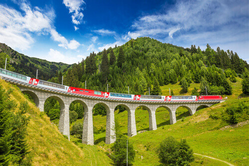 Train on famous landwasser Viaduct bridge with the Rhaetian Railway in St Moritz Switzerland