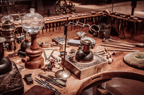 Old vintage wooden clockmaker table with tools at International Clock Making Museum of La Chaux de Fonds in Neuchatel Switzerland