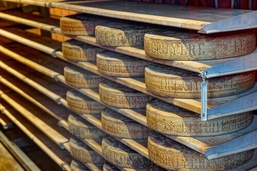 Aging cheese in a cellar of the Maison du Gruyere cheese factory in Switzerland