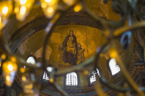 Blessed Virgin Mary with Baby Jesus Byzantine Mosaic art on Hagia Sophia Apse in Istanbul Turkey