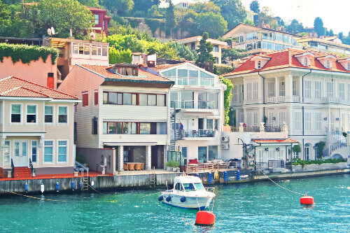 Arnavutkoy city at the coast of the Bosphorus with colourful old wooden houses in Istanbul Turkey