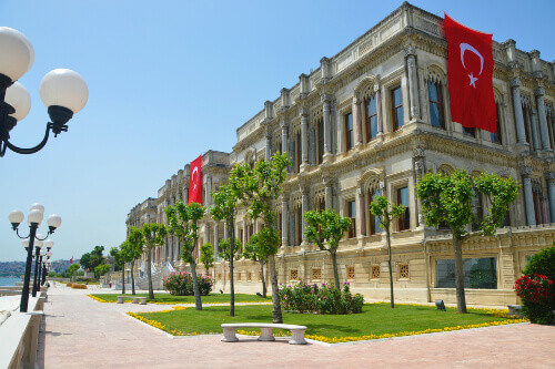 Exterior view of Ciragan Palace and the gardens, a historic former Ottoman Palace in Istanbul Turkey