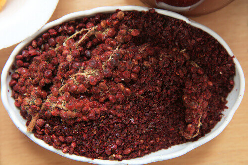 A handful of red sumac powder in a plate in Turkey
