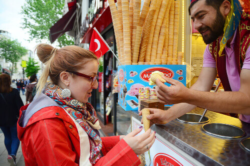 Dorduma or Turkish ice cream being sold to a tourist in Istanbul Turkey