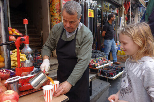 Street vendor selling fresh pomegranate juice in Istanbul Turkey