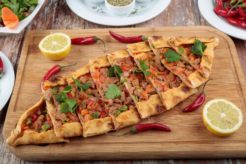 Traditional turkish baked dish called Pide or Turkish Pizza