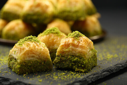 Turkish Baklava is a mediterranean pastry with walnut and pistachio