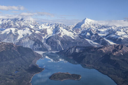 Aerial of Lituya Bay with Mt. Fairweather range in the background on a sunny day in Alaska