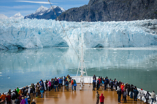 Passengers get a close-up view of the majestic glaciers as they sail in Glacier Bay National Park and Preserve in Alaska