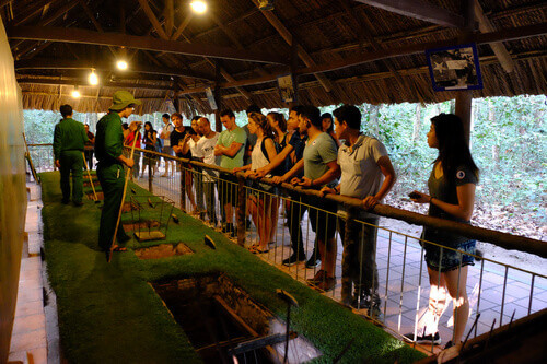 The staff showing use the trap in Cu Chi tunnels in Cu Chi Vietnam
