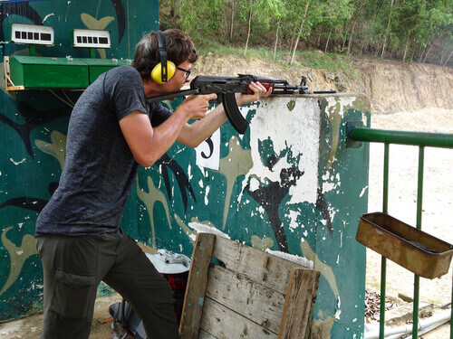 Tourist shooting AK 47 on a shooting range a tourist attraction in Cu Chi Tunnels in Vietnam