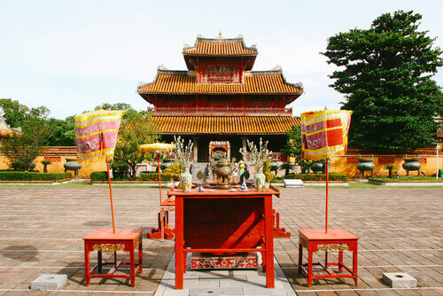 The worshiping altar and gate in front of The Mieu with Nine Dynastic Urns inside the Imperial City complex in Hue Vietnam