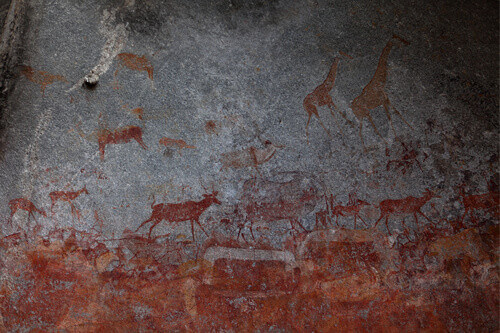 Ancient rock paintings in Nswatugi Cave in Matobo National Park in Zimbabwe