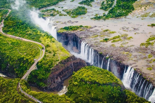 Victoria Falls or Mosi-oa-Tunya which translates to The Smoke that Thunders in South Africa