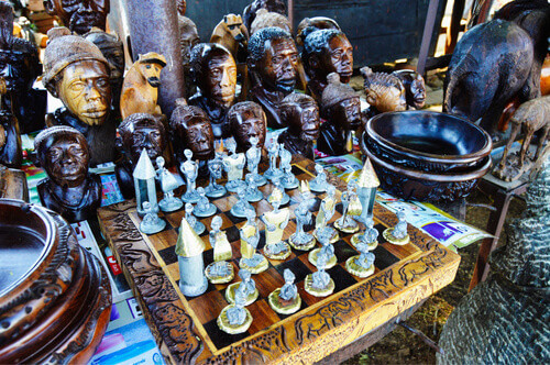 African made chess board and wooden faces in the background souvenirs in Harare Zimbabwe