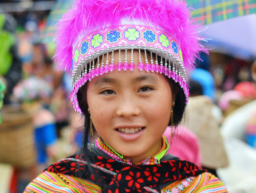 Hmong hill tribe woman in colorful traditional Flower Hmong costume