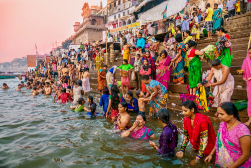 many people bathing in ganges
