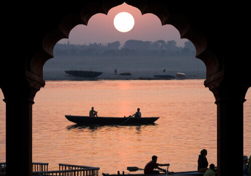 Ganges with boat at sunset india
