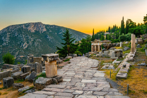 sunset at athenian treasury delphi greece
