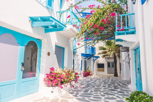 streets of mykonos with bougainvilleas greece