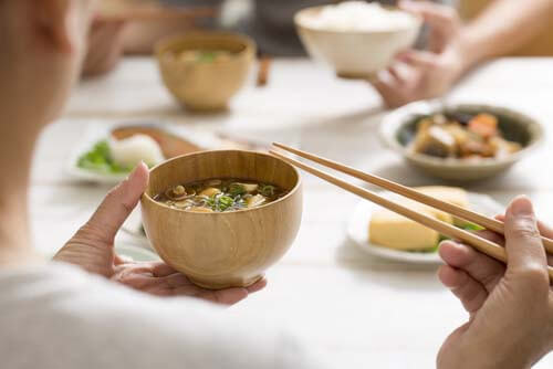 using chopsticks with miso soup japan
