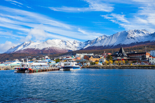 Ushuaia port with boats and mountains