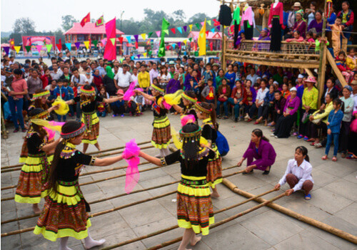 children playing folk games hung kings festival vietnam