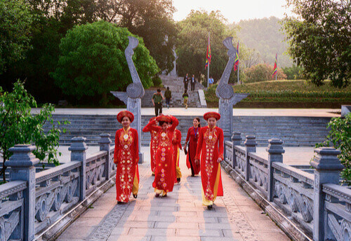 women in costume on bridge in phu tho vietnam